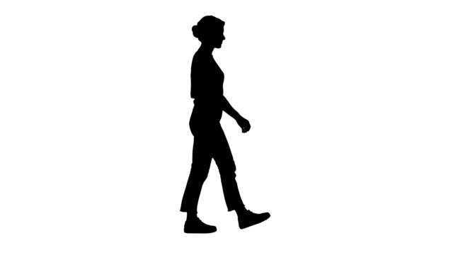 Silhouette Woman in red t-shirt, jeans and sneakers walking Full length shot. Side view. Silhouette Woman in red t-shirt, jeans and sneakers walking. Professional shot in 4K resolution. 006. You can use it e.g. in your commercial video, business, presentation, broadcast silhouette people stock videos & royalty-free footage