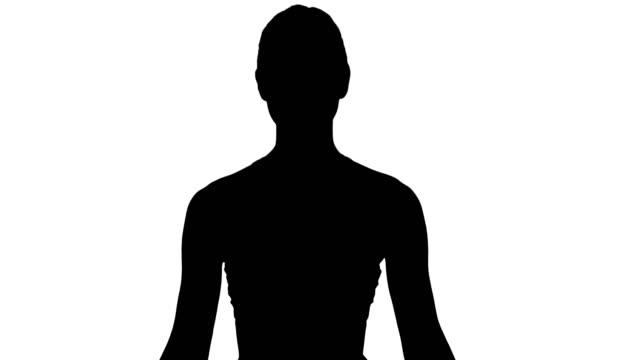 silhouette woman practicing yoga meditation smiling - mudra video stock e b–roll