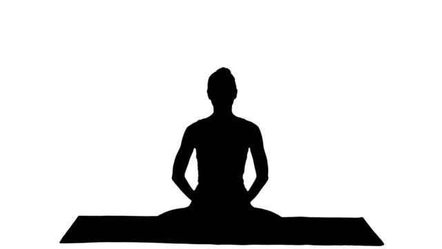 Silhouette Young beautiful blonde woman doing yoga and smiling