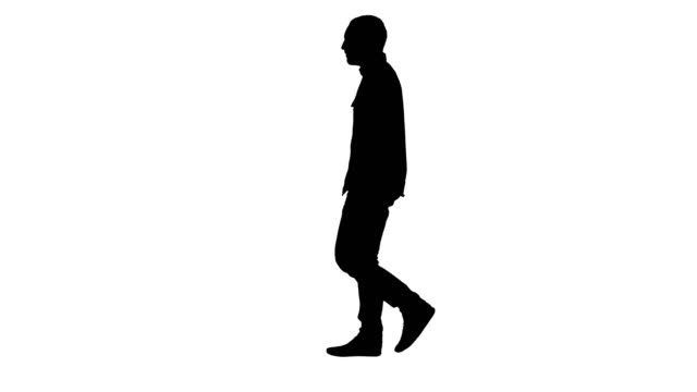 Silhouette Young casual man walking Full length portrait side view. Silhouette Young casual man walking. Professional shot in 4K resolution. 004. You can use it e.g. in your commercial video, business, presentation, broadcast silhouette people stock videos & royalty-free footage