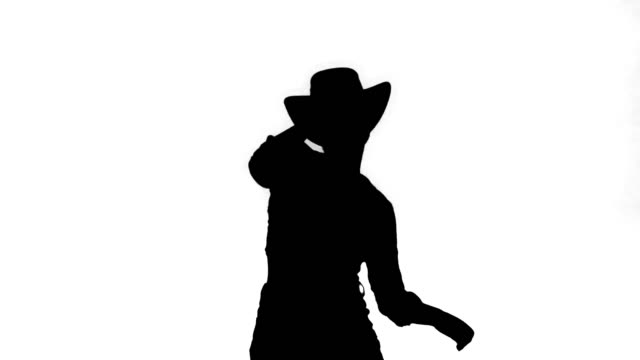 Silhouette Young lady in a cowboy hat dancing