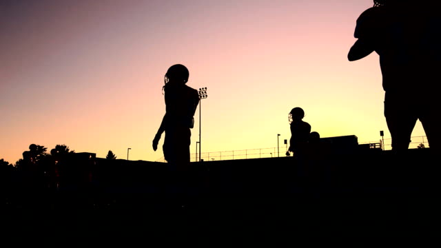 Silhouetted Football Players video