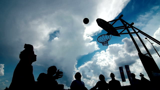 silhouettes of basketball players at the sunset video