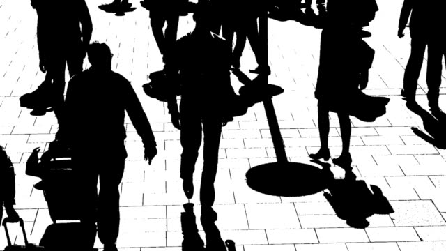 B/W Silhouettes Of City People On The Move video