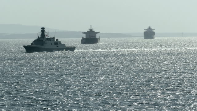 silhouettes of military and cargo ships in the Dardanelles strait video