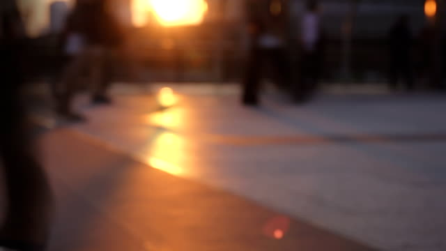 HD SLOW MOTION: Silhouettes of Pedestrians Commuting in City.