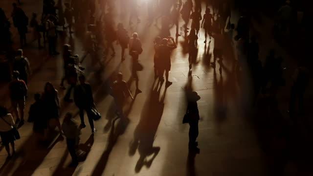 Silhouettes of Pedestrians Commuting in City. video