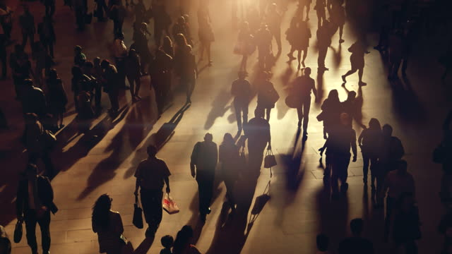 Silhouettes of Pedestrians Commuting in City.