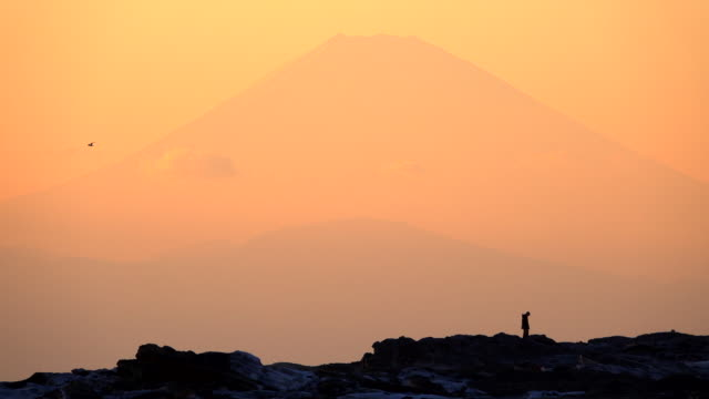 Silhouettes of people with Mt. Fuji in dusk video