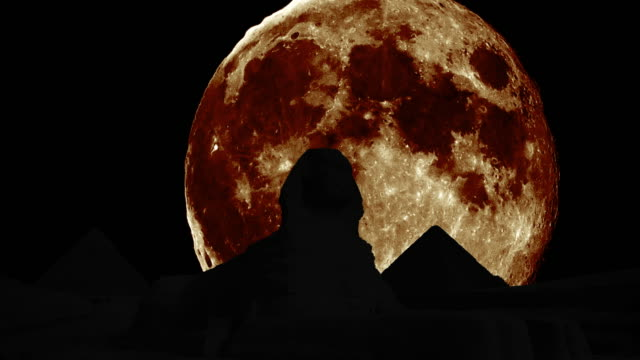 silhouettes of the Sphinx and pyramids with giant moon video