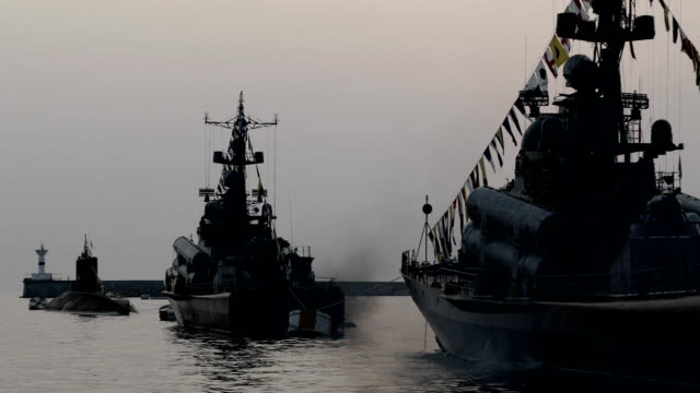 silhouettes of warships in the parade video