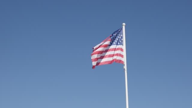 silk material of american national symbol on wind - asta oggetto creato dall'uomo video stock e b–roll