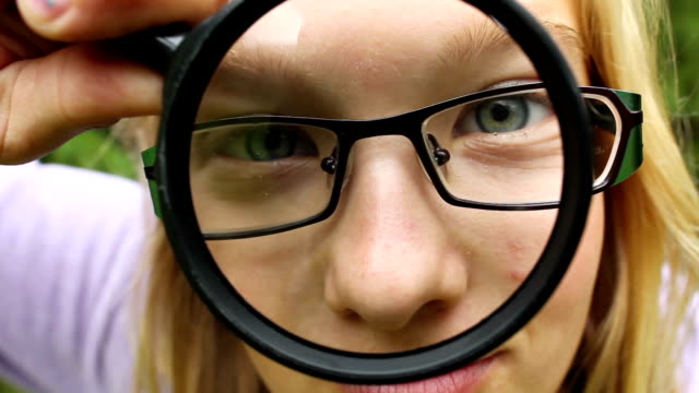 Silly girl with magnifying glass video