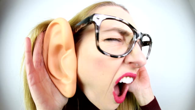 silly woman with large ears - orecchio umano video stock e b–roll