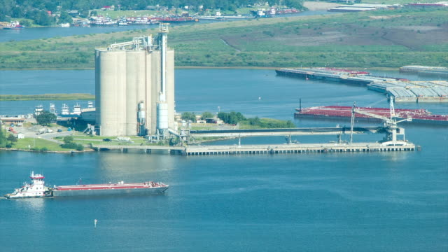 Silos and Barges in the Houston TX Shipping Channel video