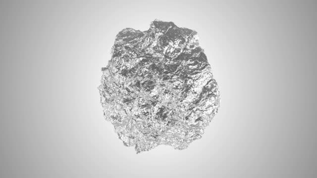 silver aluminium sphere morphing into foil seamless loop 4k animation video. - metallizzato video stock e b–roll