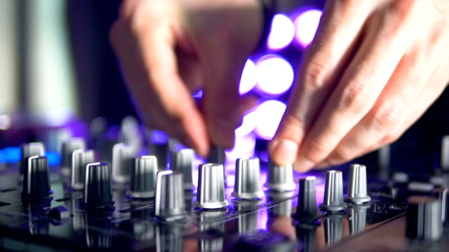 Silver and black mixer knobs in use. video