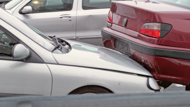 slo mo silver car hitting a red car from behind - incidente video stock e b–roll