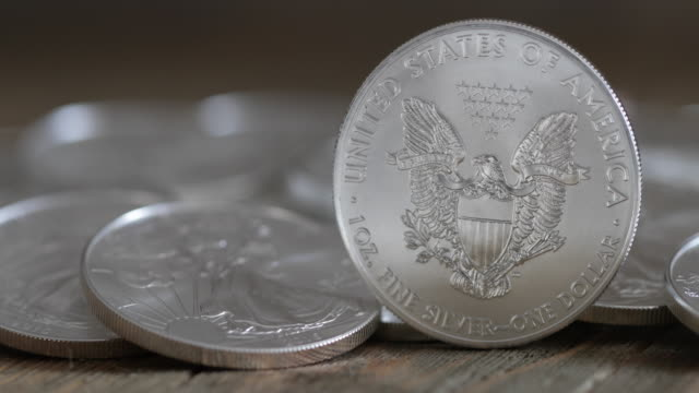 silver eagle coins - 4k - argentato video stock e b–roll