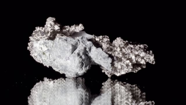 silver ore rotating on black - argentato video stock e b–roll