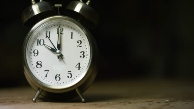 A Silver-Colored, Metal, Retro-Style, Analog Alarm Clock at 10:00