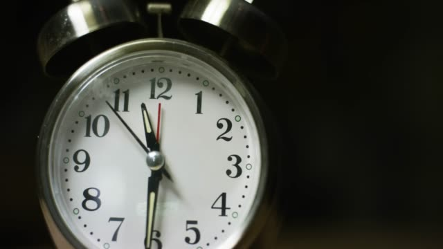 A Silver-Colored, Metal, Retro-Style, Analog Alarm Clock at 11:30