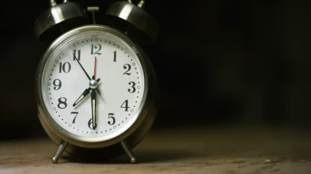 A Silver-Colored, Metal, Retro-Style, Analog Alarm Clock at 7:30