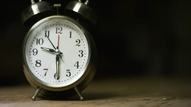 A Silver-Colored, Metal, Retro-Style, Analog Alarm Clock at 9:30