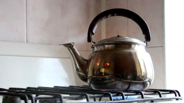 simmering whistling kettle on the old stove. - teapot stock videos & royalty-free footage