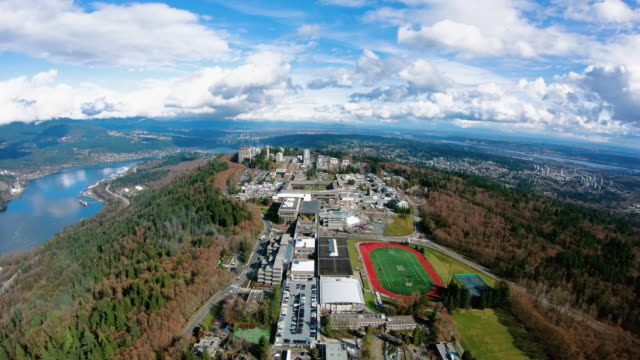 simon fraser university burnaby canada bc aerial view - fiume fraser video stock e b–roll