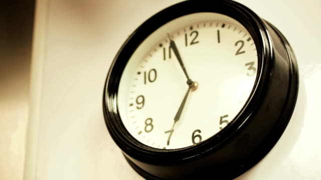Simple round clock on the wall. Simple round clock on the wall. wall clock stock videos & royalty-free footage