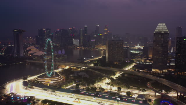 Singapore city in twilight, aerial view real time