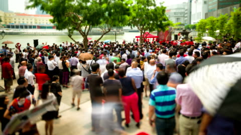 Singapore General Election 2015 Office workers listening to candidates giving speeches political rally during lunch break at Raffles Place, Central Business District of Singapore. Time Lapse Photography. 2015 stock videos & royalty-free footage