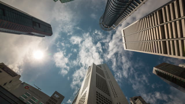 singapore sunny cloud skyscrapers up view 4k time lapse