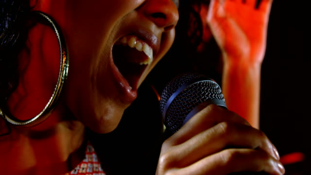 singer performing on stage at a concert 4k - cantante video stock e b–roll