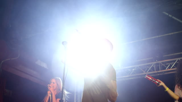 singers performing on stage at a concert 4k - cantante video stock e b–roll