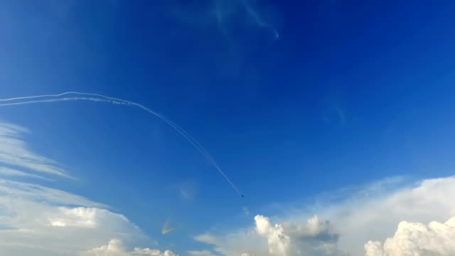 Single aerobatic plane on blue sky