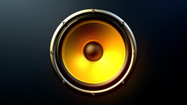 single audio speaker with orange membrane playing modern music seamless loop - głośnik filmów i materiałów b-roll