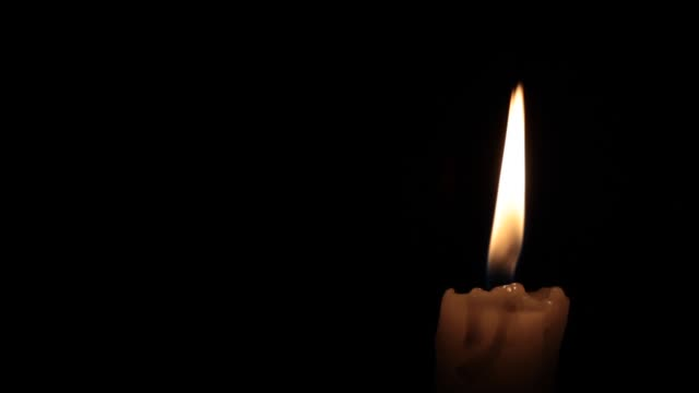 Single candle flame video