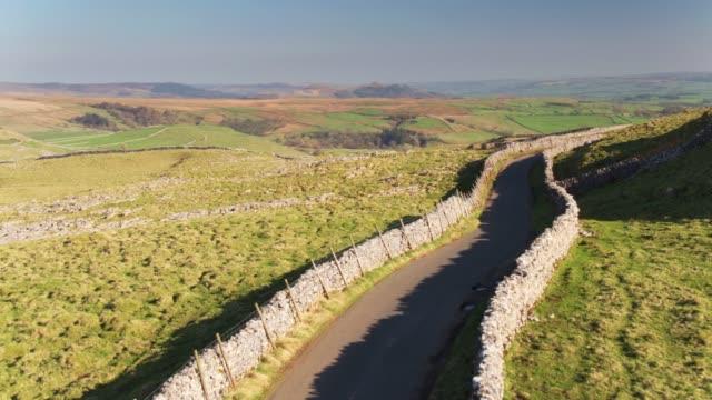 Single Lane Road Across Yorkshire Dales - Drone Shot
