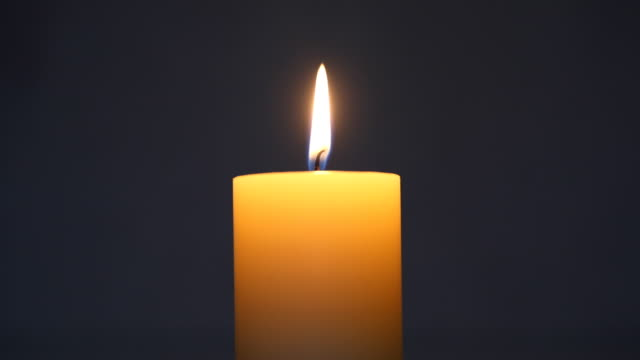 Single lit candle Single lit candle candle stock videos & royalty-free footage