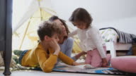 istock Single Mother Reading With Son And Daughter In Den In Bedroom At Home 1166588860