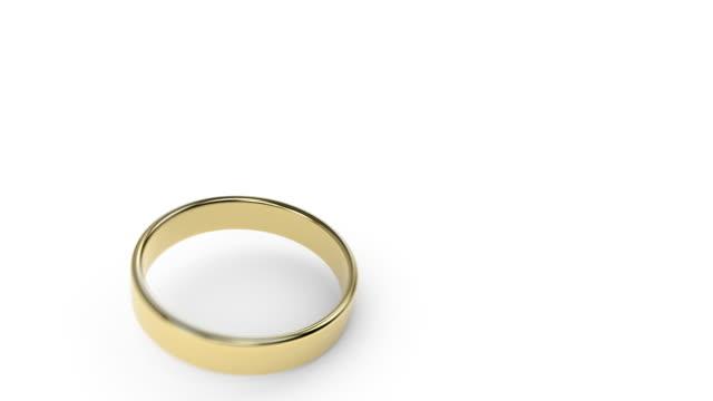Single ring falling on white slow motion