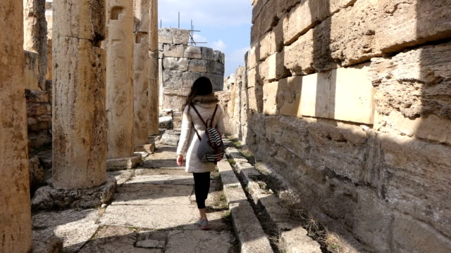 single woman is walking inside the Hierapolis hierapolis, pamukkale, greek culture, turkey athens greece stock videos & royalty-free footage