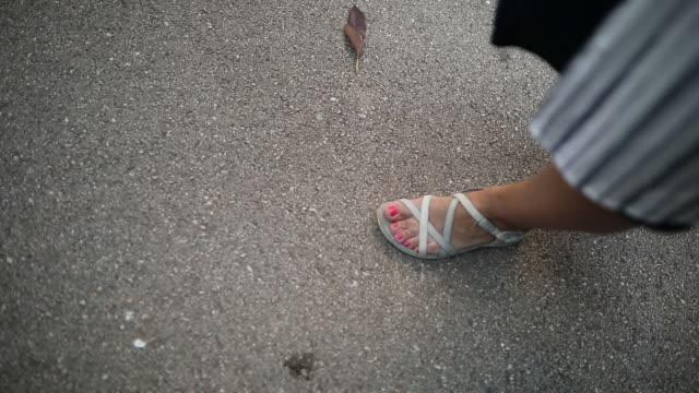 Single woman walking in the park