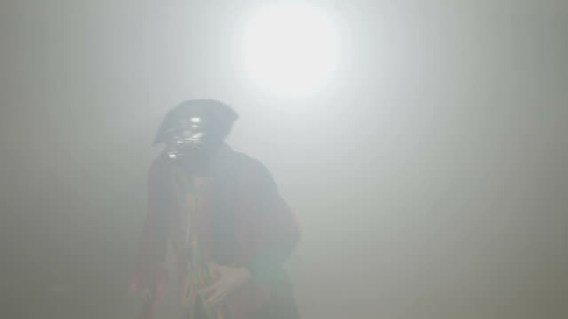 Sinister Zombie Psycho With Mask On His Face Coming Out From Fog And