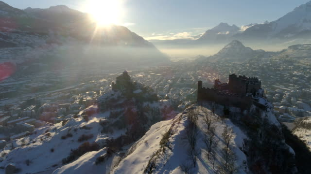 Sion hills in snow, close up - Aerial 4K - Phantom 4 PRO Valère and Tourbillon castle, Valais - Switzerland fort stock videos & royalty-free footage