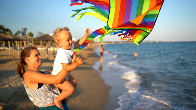 Sister and little brother playing with kite