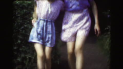 1949: Sisters dancing outdoor garden blond caucasian girls enjoying summer. . carefree stock videos & royalty-free footage