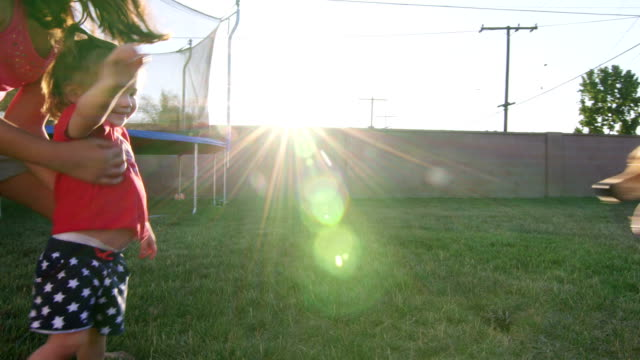 Sisters Play Together on Grass with Dog video